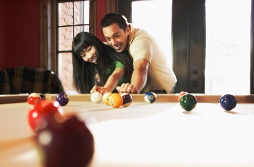 Stock Photo: 1555R-314395 Couple playing pool
