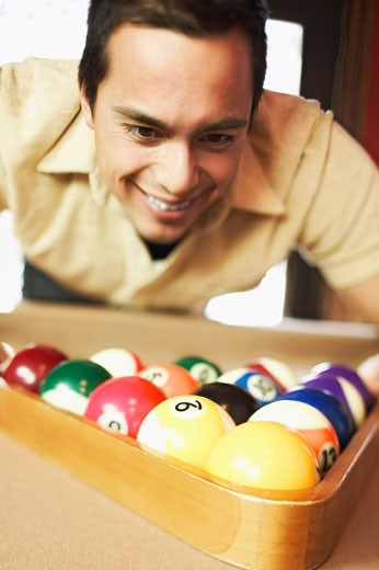 Man with pool balls : Stock Photo