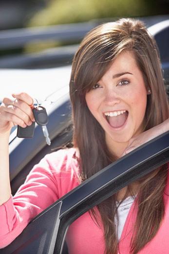 Girl holding car keys : Stock Photo