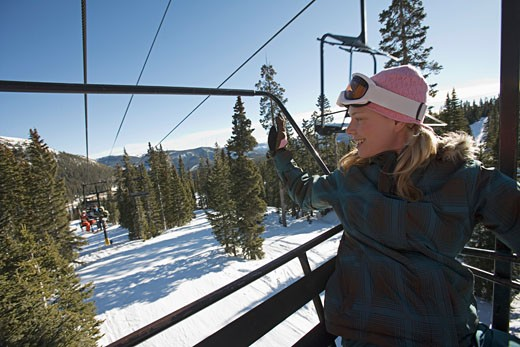 Stock Photo: 1555R-314663 Woman waving on chairlift