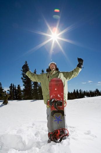 Stock Photo: 1555R-314677 Triumphant snowboarder