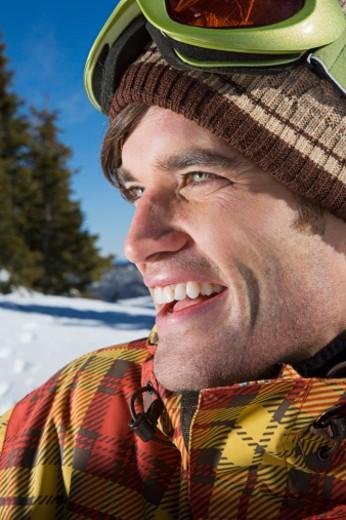 Man in winter attire wearing goggles : Stock Photo