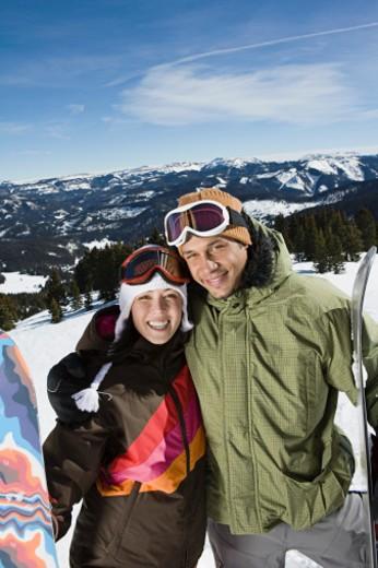 Stock Photo: 1555R-314688 Portrait of snowboarding couple