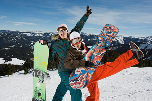 Playful snowboarding friends : Stock Photo