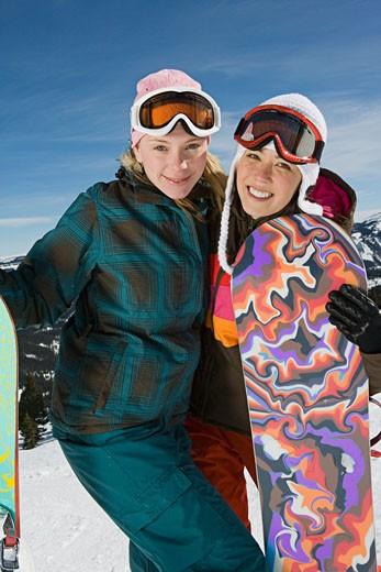 Portrait of women snowboarding friends : Stock Photo