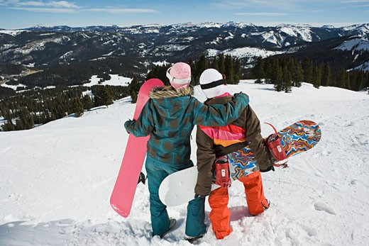 Back view of women with snowboards : Stock Photo