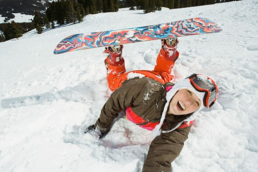 Fallen snowboarder : Stock Photo