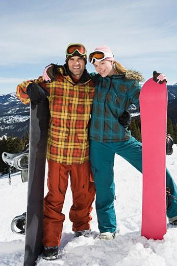 Portrait of snowboarding couple : Stock Photo