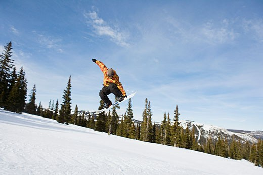 Stock Photo: 1555R-314709 Snowboarder in midair