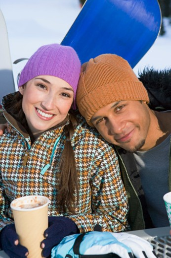 Stock Photo: 1555R-314715 Snowboarding couple taking a break