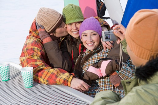 Stock Photo: 1555R-314719 Man taking a picture of friends