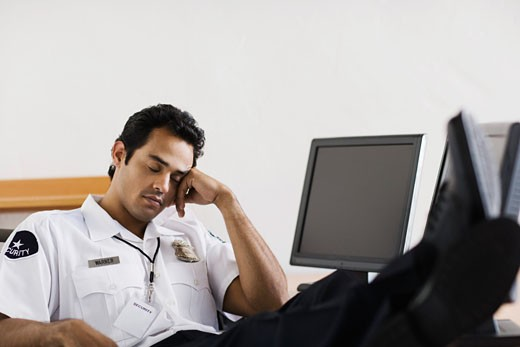 Stock Photo: 1555R-315503 Sleeping security guard at station