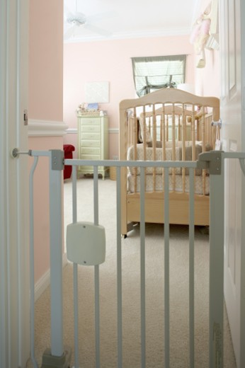 Nursery with safety gate : Stock Photo
