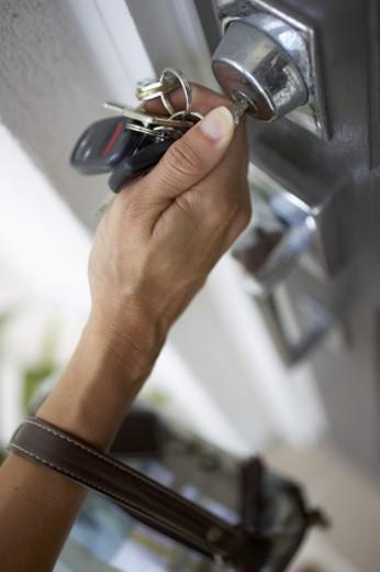 Hand unlocking door lock : Stock Photo