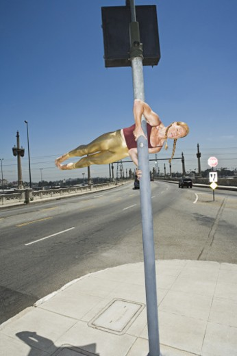 Stock Photo: 1555R-316017 Acrobat balanced on pole