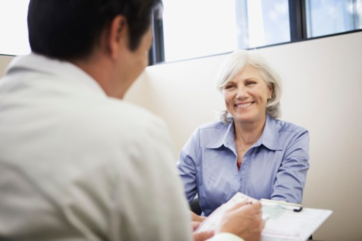 Stock Photo: 1555R-316308 Smiling patient meeting with doctor