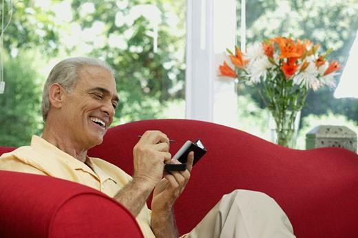 Stock Photo: 1555R-318448 Man using PDA