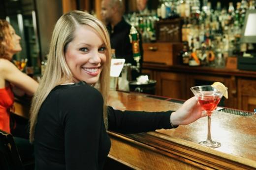Smiling woman at bar : Stock Photo