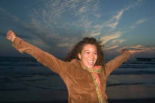 Stock Photo: 1555R-319250 Teenage girl with arms outstretched