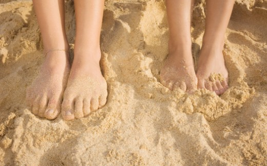 People with bare feet in sand : Stock Photo
