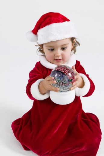 Stock Photo: 1555R-320375 Girl with snow globe
