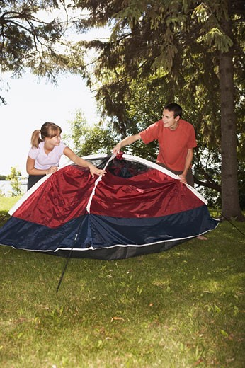 Couple pitching tent : Stock Photo