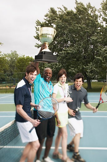 Yelling tennis players with trophy : Stock Photo
