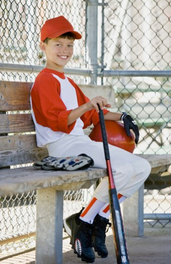 Boy in baseball uniform : Stock Photo