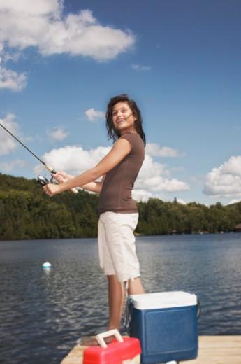 Teenage girl fishing : Stock Photo