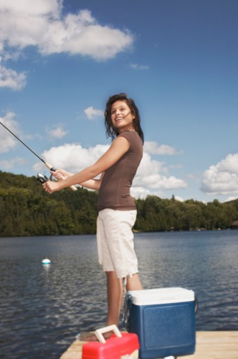 Stock Photo: 1555R-322200 Teenage girl fishing