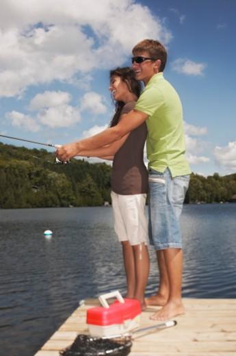Teenage couple fishing : Stock Photo