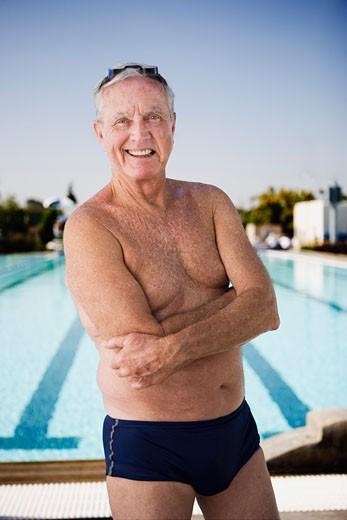 Stock Photo: 1555R-322223 Smiling senior man swimmer