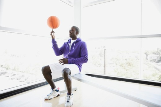 Stock Photo: 1555R-322411 Athlete spinning basketball on finger