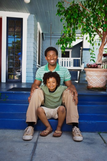 Father and son seated on porch steps : Stock Photo