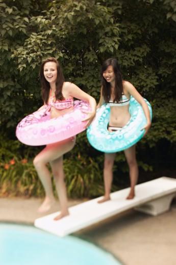 Teenage girls with swim rings : Stock Photo