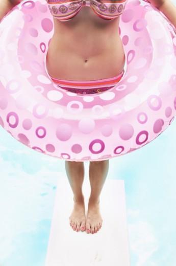 Cropped teenage girl with swim ring : Stock Photo