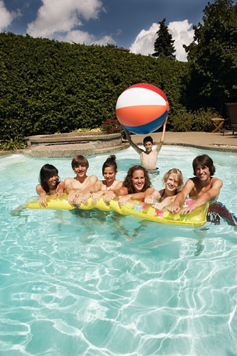 Teenagers in swimming pool : Stock Photo