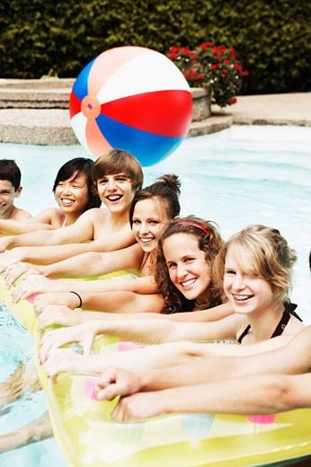Teenagers in swimming pool : Stock Photo