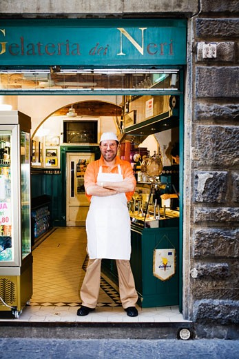 Shopkeeper in doorway, Florence, Italy : Stock Photo