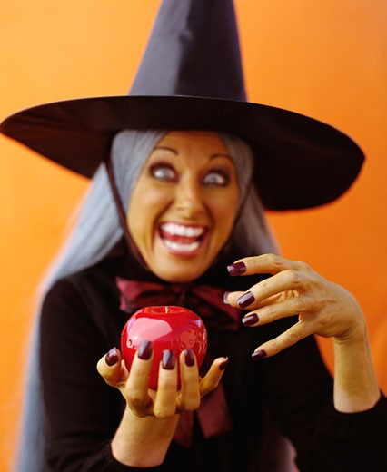 Witch holding apple : Stock Photo