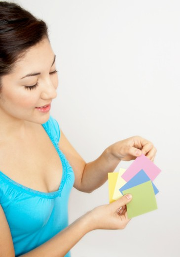 Stock Photo: 1555R-324556 Woman with paint swatches