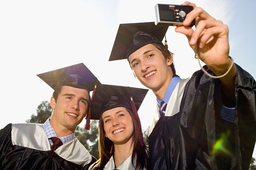 Graduates taking a picture : Stock Photo