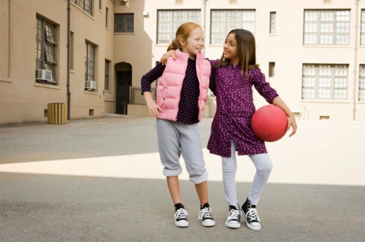 Stock Photo: 1555R-325957 Smiling girls with dodgeball