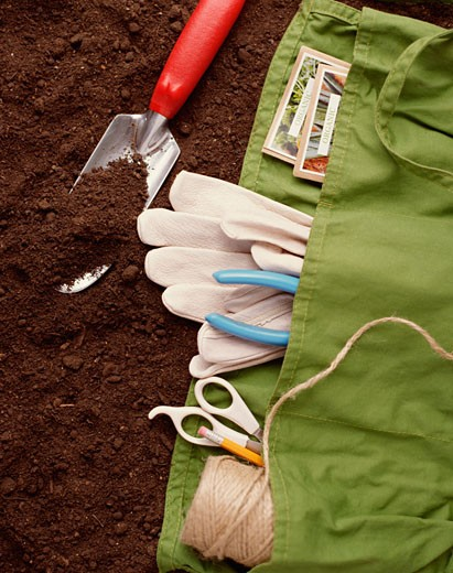Gardening supplies on dirt : Stock Photo