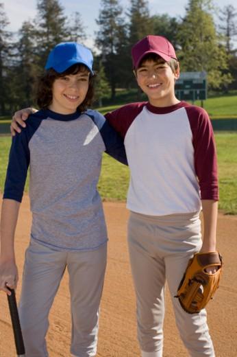 Stock Photo: 1555R-326892 Portrait of boys on baseball field