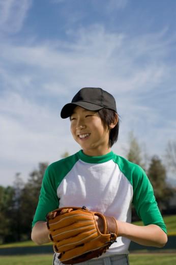 Stock Photo: 1555R-326896 Portrait of boy on baseball field with mitt