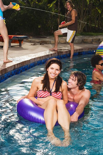 Couple in pool : Stock Photo