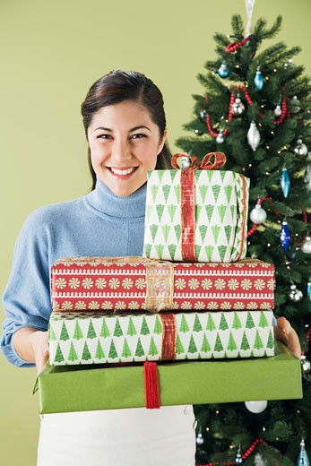 Woman with stack of gifts : Stock Photo