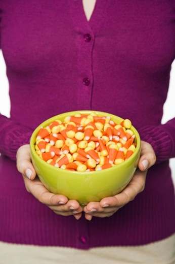 Stock Photo: 1555R-327558 Woman with bowl of candy corn