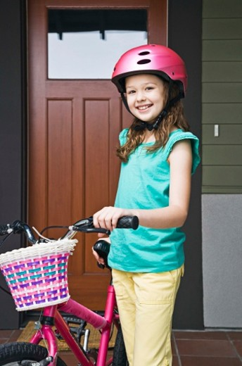 Girl with bicycle and helmet : Stock Photo